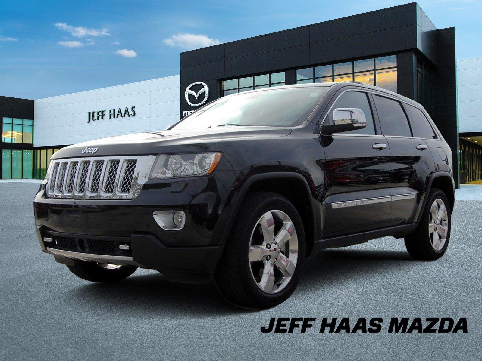 Pre-Owned 2013 Jeep Grand Cherokee 4WD 4dr Overland Summit